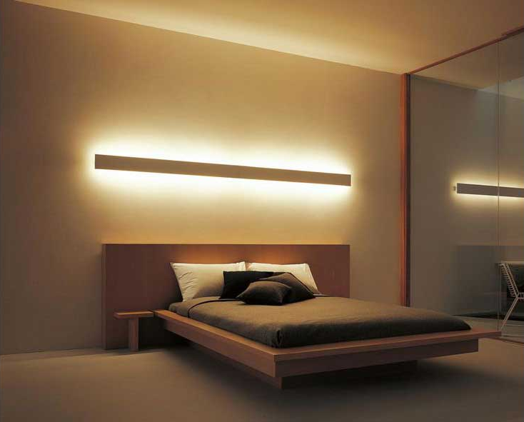 A bed with a light above it  Description automatically generated with low confidence