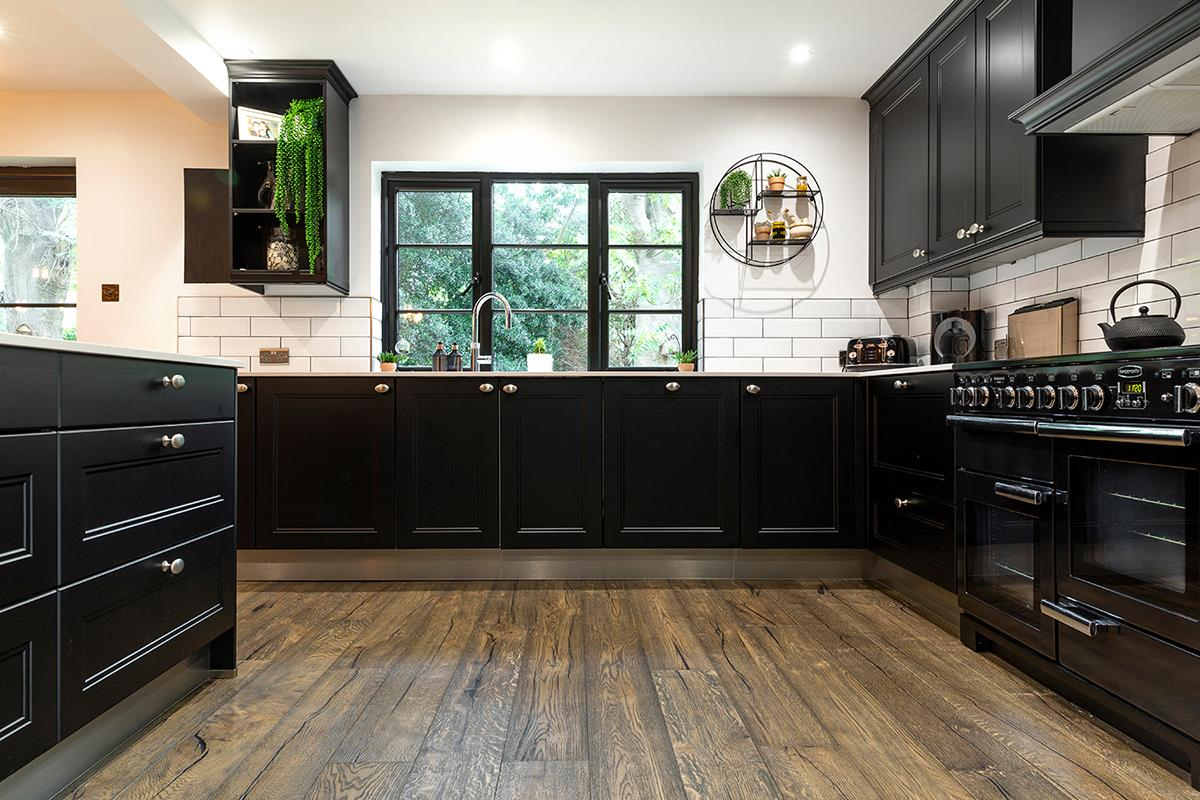 A kitchen with black cabinets  Description automatically generated with medium confidence