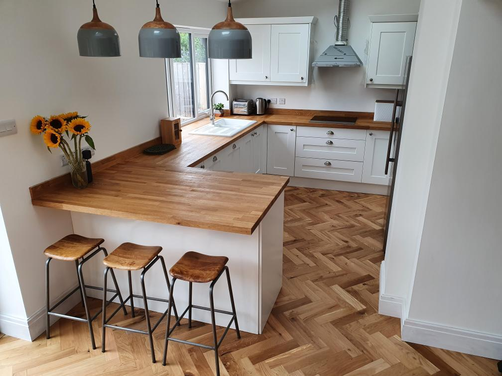 A kitchen with stools and stools  Description automatically generated with medium confidence