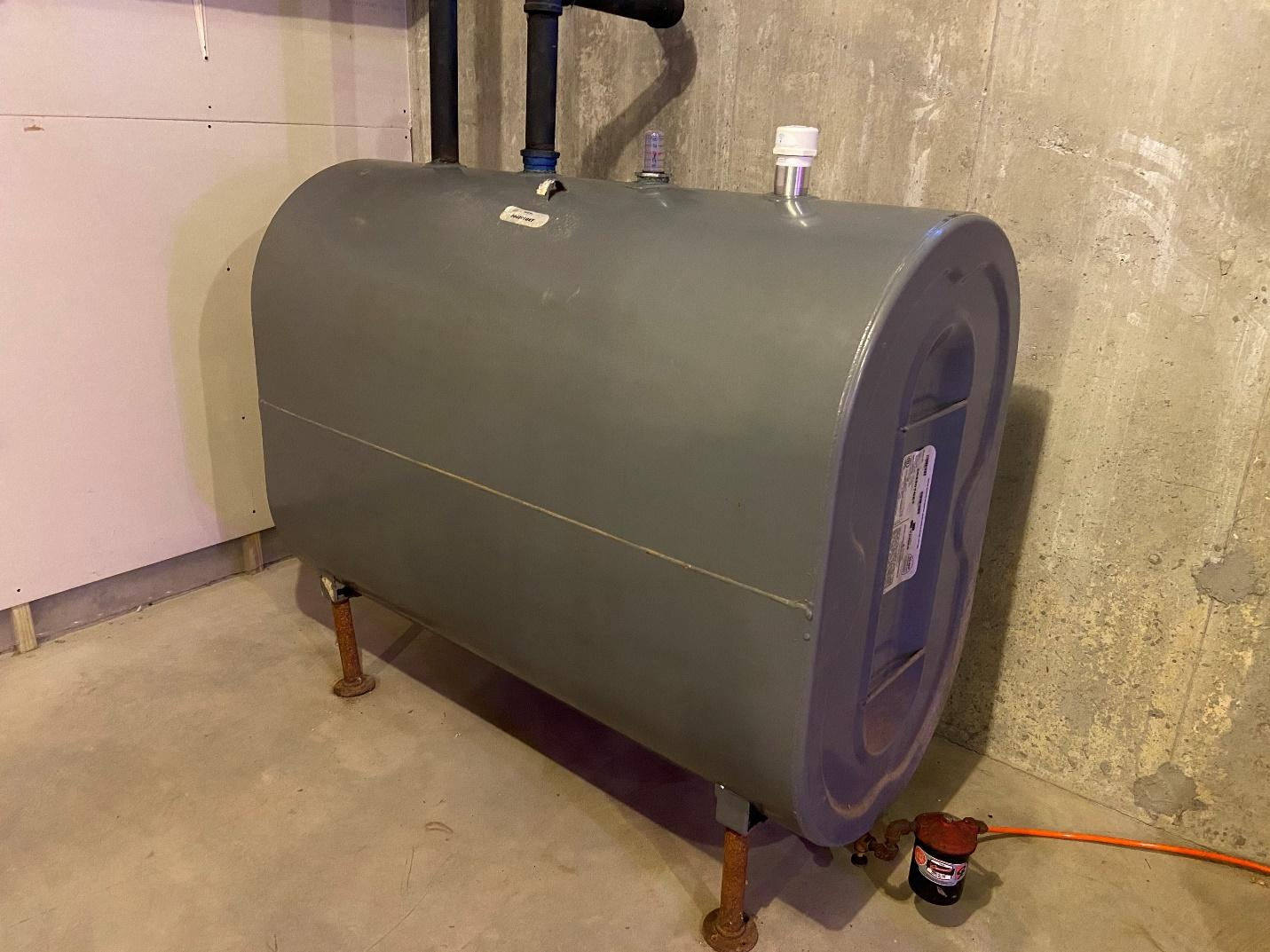 A dry basement is the best place for a home heating oil tank to be stored. Since moisture is the enemy of a steel tank like this, ensuring it stays dry is the best thing you can do to extend the life of your oil tank.